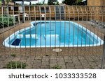 fenced swimming pool. swimming... | Shutterstock . vector #1033333528
