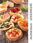 assorted bruschettas on wood... | Shutterstock . vector #1033340140