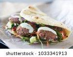 tasty vegan falafel wrap shot... | Shutterstock . vector #1033341913