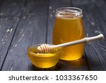 honey in jar with honey dipper... | Shutterstock . vector #1033367650