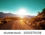 road in the prairie country | Shutterstock . vector #1033370158