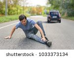 Small photo of Hit and run concept. Injured man on road in front of a car.