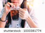 closeup woman drinking ice cola ... | Shutterstock . vector #1033381774
