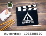 update. movie clapper on a... | Shutterstock . vector #1033388830