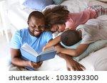 african american man reading...   Shutterstock . vector #1033393300