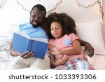 African American Man Reading...