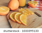 oranges on a cutting board and... | Shutterstock . vector #1033395133
