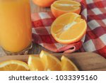 oranges on a cutting board and... | Shutterstock . vector #1033395160