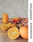 oranges on a cutting board and... | Shutterstock . vector #1033395163