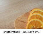 oranges on a cutting board and... | Shutterstock . vector #1033395193