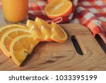 oranges on a cutting board and... | Shutterstock . vector #1033395199