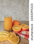 oranges on a cutting board and... | Shutterstock . vector #1033395223