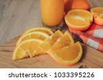 oranges on a cutting board and... | Shutterstock . vector #1033395226