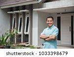 proud young asian man standing...   Shutterstock . vector #1033398679