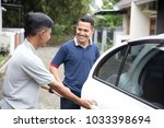 asian male taxi driver opening... | Shutterstock . vector #1033398694