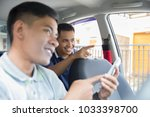 happy customer telling driver... | Shutterstock . vector #1033398700
