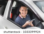young handsome male using... | Shutterstock . vector #1033399924