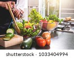 young happiness woman cooking... | Shutterstock . vector #1033404994