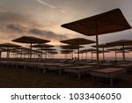 silhuettes of beach loungers... | Shutterstock . vector #1033406050