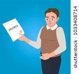 a man holds a divorce document...