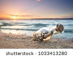 message in a bottle at the beach | Shutterstock . vector #1033413280