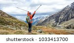 young woman hiking in the... | Shutterstock . vector #1033413700