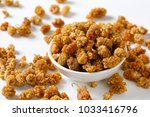bowl of dried white mulberries  ... | Shutterstock . vector #1033416796