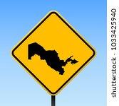 uzbekistan map road sign.... | Shutterstock .eps vector #1033425940