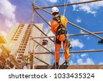 workers up high with safety... | Shutterstock . vector #1033435324