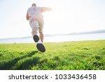 outdoor cross country running... | Shutterstock . vector #1033436458