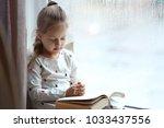 religious christian girl... | Shutterstock . vector #1033437556
