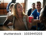 frieds cheering sport at bar... | Shutterstock . vector #1033445203