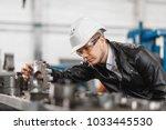 factory engineer checks the... | Shutterstock . vector #1033445530