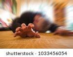 a man lies unconscious in his... | Shutterstock . vector #1033456054