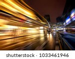 a car road in a bustling city... | Shutterstock . vector #1033461946