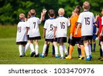 happy football players giving... | Shutterstock . vector #1033470976