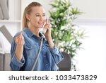 beautiful woman talking on... | Shutterstock . vector #1033473829