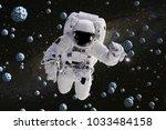 astronaut flying between... | Shutterstock . vector #1033484158