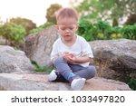 cute smiling little asian 18... | Shutterstock . vector #1033497820