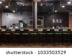 Stock photo bar counter with bar chairs in loft style design strobe light on dark ceiling 1033503529