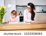 mother working from home and... | Shutterstock . vector #1033508083