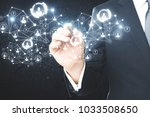 businessman hand with abstract... | Shutterstock . vector #1033508650