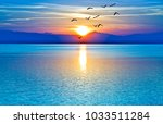 sunrise over the mountains and... | Shutterstock . vector #1033511284