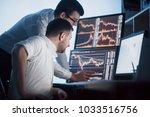 team of stockbrokers are having ... | Shutterstock . vector #1033516756