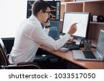 stockbroker in shirt is working ... | Shutterstock . vector #1033517050