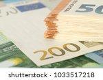 closeup of many euro bills | Shutterstock . vector #1033517218
