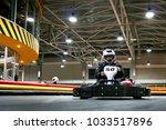 the man is going on the go kart ... | Shutterstock . vector #1033517896