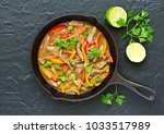 stir fry with sage and pepper   | Shutterstock . vector #1033517989