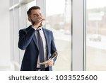 portrait of handsome bearded... | Shutterstock . vector #1033525600