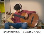 young playing guitar with...   Shutterstock . vector #1033527700